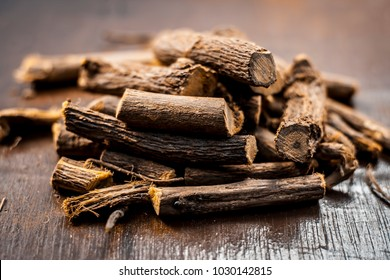 Close up of Ayurvedic herb Liquorice root,Licorice root, Mulethi or Glycyrrhiza glabra root on a wooden surface is very much beneficial for Soothes your stomach,poisoning, stomach ulcers, etc.