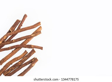 Close up of Ayurvedic herb Liquorice root,Licorice root, Mulethi or Glycyrrhiza glabra root on a wooden surface is very much beneficial for Soothes your stomach,poisoning, stomach ulcers