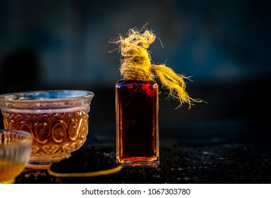 Close up of ayurvedic treatment consisting of kalonji, Roman coriander with honey, black tea and its extracted oil on a wooden surface helps to reduce the weight, and good for skin and health care.