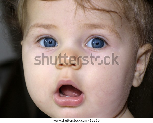 Close up of baby's face with surprised expression