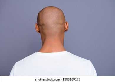 Close up back behind rear view photo dark skin he him his man turned to empty space distracted unrecognizable groomed shaved head wearing white t-shirt outfit clothes isolated on grey background