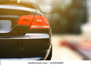 close up the back of car with bokeh background