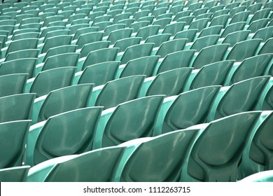 Close up of back of a mint green arena seats