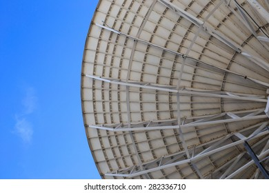 close up of back of satellite dish with sky background