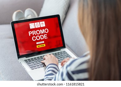 Close up back woman shopping online with promo code on laptop add to cart function webpage at sofa in home,Digital marketing concept.digital lifestyle living