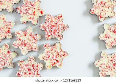 Close up of background of chocolate peppermint bark snowflakes with copy space in middle