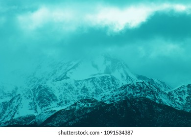 Close up background image of snow capped mountains in New Zealand with copy space