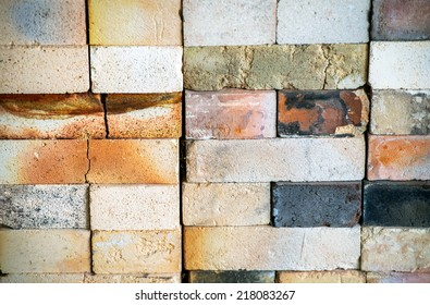 A close up background image of the texture of worn, cracked fire bricks in a kiln used to fire pottery wares.