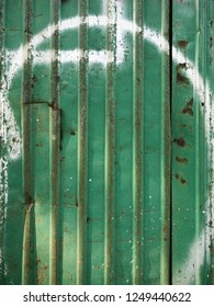 close up background of rusted galvanized iron plate in green color with white painting