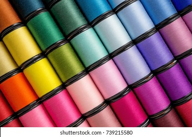Close up Background Spool of sewing threads colorful sort in diagonal.