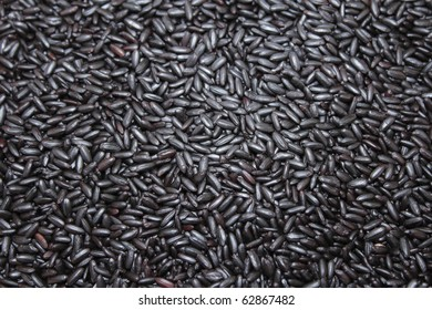 Close up background view of organic black purple rice.