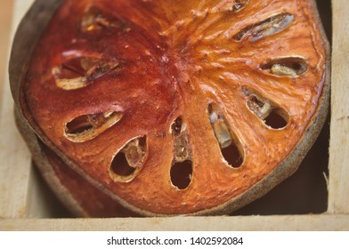 Close up bael fruit dry in wooden box