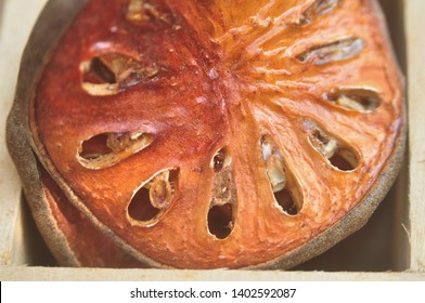 Close up bael fruit in wooden box