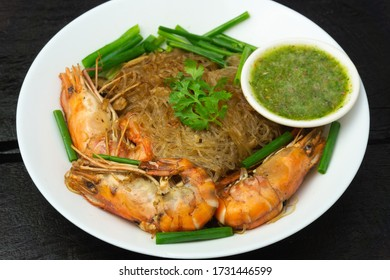 Close up of baked Shrimp with vermicelli and Seafood sauce on Black background