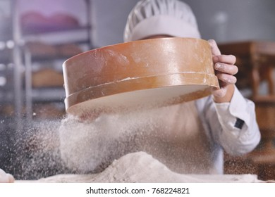 Close up of a baker kneading with his hands to prepare the bread to put in the oven. Concept of: artisan, baker, raw materials, love for food and traditions