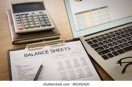 close up balance sheet report of company's financial statement on desk of accountant.  Preparation of accounts.