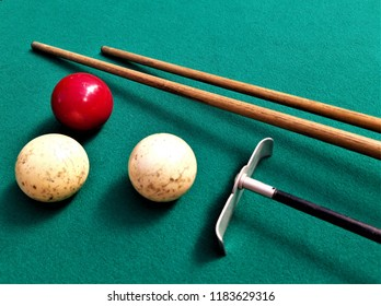 Close up of a balls and stick on a pool table