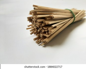 close up of bamboo stick or food skewers or puncture on white background