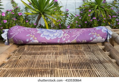 Close up of a bamboo sun bed on a tropical beach