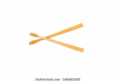 Close up bamboo toothbrush on white background.