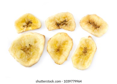 Close up banana chips isolated on white background. Top view