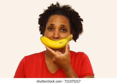 Close up Banana Smile Woman looking at camera