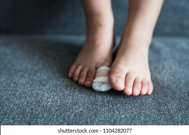close up of bandage on kid big toe. intended selecitve focused and add noise. - Shutterstock ID 1104282077
