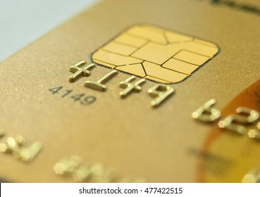 Close Up bank card chip. Macro shot of Electronic chip on a credit card or debit card.