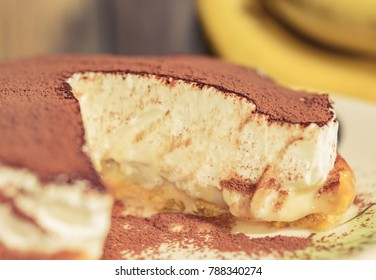 close up Banoffee cake (banana cream cake) detail pattern on wood table with selective focus