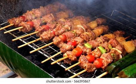 Close up barbecue grills at barbecue party on barbecue grill at countryside in holiday.BBQ with pineapples.outdoor party.