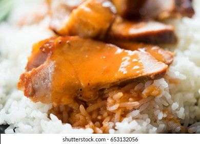 Close up Barbecued red pork in sauce with rice, Chinese style roasted pork.