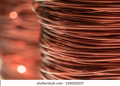 Close up of the bare bright copper wire on the spool
