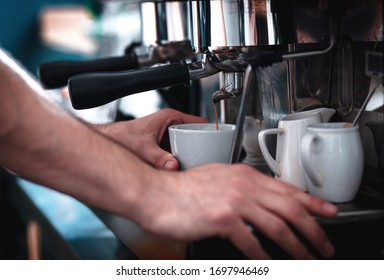 Close up of barista hands preparing cappuccino in cafe shop.