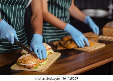 Close up of baristas preparing sandwiches in the bar