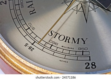 "A close up of a barometer showing the word ""stormy"""