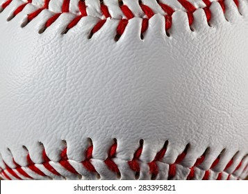 A close up of a baseball showing the texture of the leather.