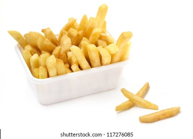 close up of basket of fries on white background
