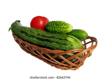 close up basket with vegetables isolated on white background