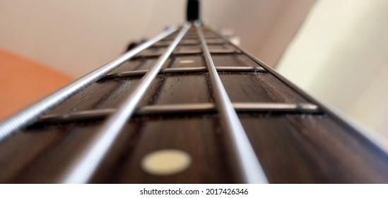 close up bass guitar fret