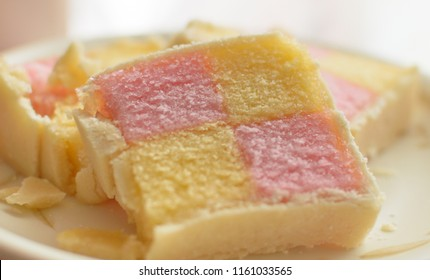 Close up of Battenberg cake B, light sponge cake with the pieces covered in jam, shallow depth of field food photography
