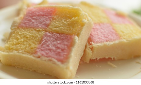 Close up of Battenberg cake C, light sponge cake with the pieces covered in jam, shallow depth of field food photography