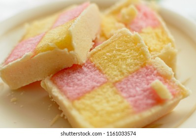 Close up of Battenberg cake E, light sponge cake with the pieces covered in jam, shallow depth of field food photography