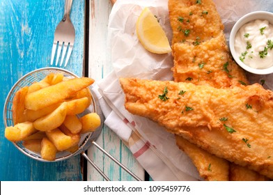 Close up battered fish and chips with mayonnaise sauce