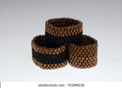 Close up of beaded rings on a white background