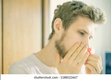 close up bearded  man portrait suffer from waund nose bleed using wadding tampon