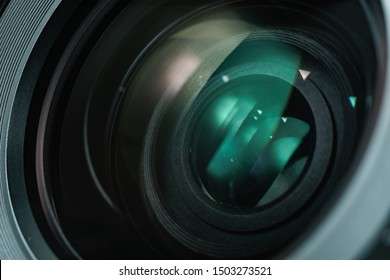 Close up beautiful camera lens with color reflection  background.