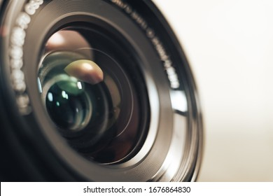 Close up beautiful camera lens on a gray background.