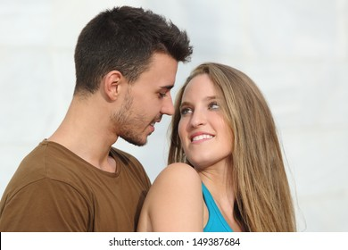 Close up of a beautiful couple looking each other with love outdoor