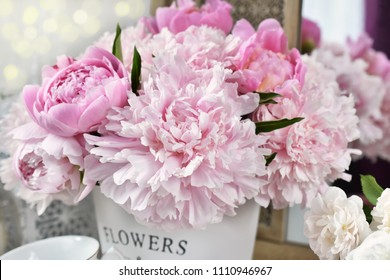 close up of beautiful fresh peony flower bunch in metal bucket