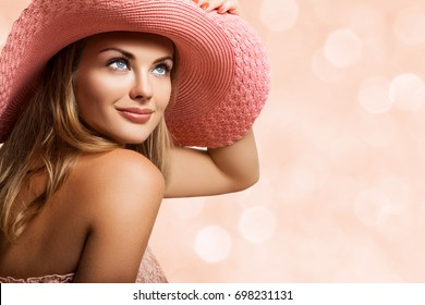 Close up Beautiful Girl, Young Woman Portrait. Attractive Woman Profile. Woman is Wearing a Peach Hat on her Head, Beautiful Model Face and Soft Skin. Beauty Portrait of Summer Girl, Woman's Face
